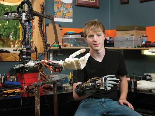 Easton with an earlier version of his robotic arm