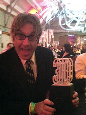 Jason Lopez with Award
