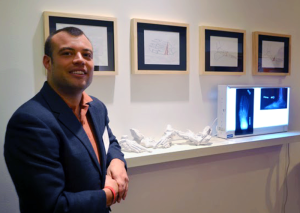 Dr Nicholas Giovinco with 3D printed feet for surgery preparation