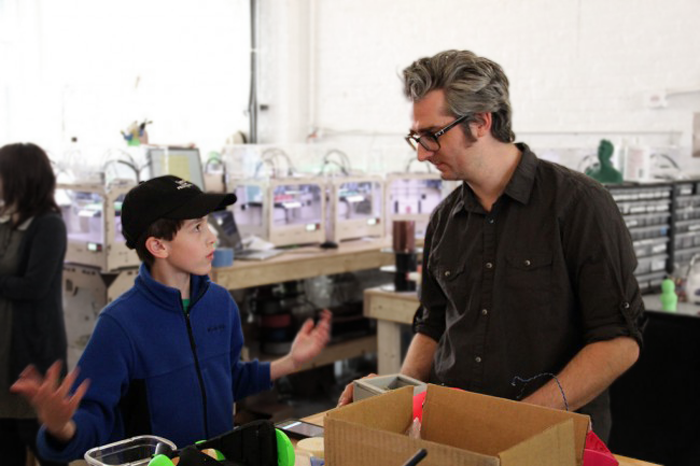 Thomas Suarez with MakerBot's Bre Pettis