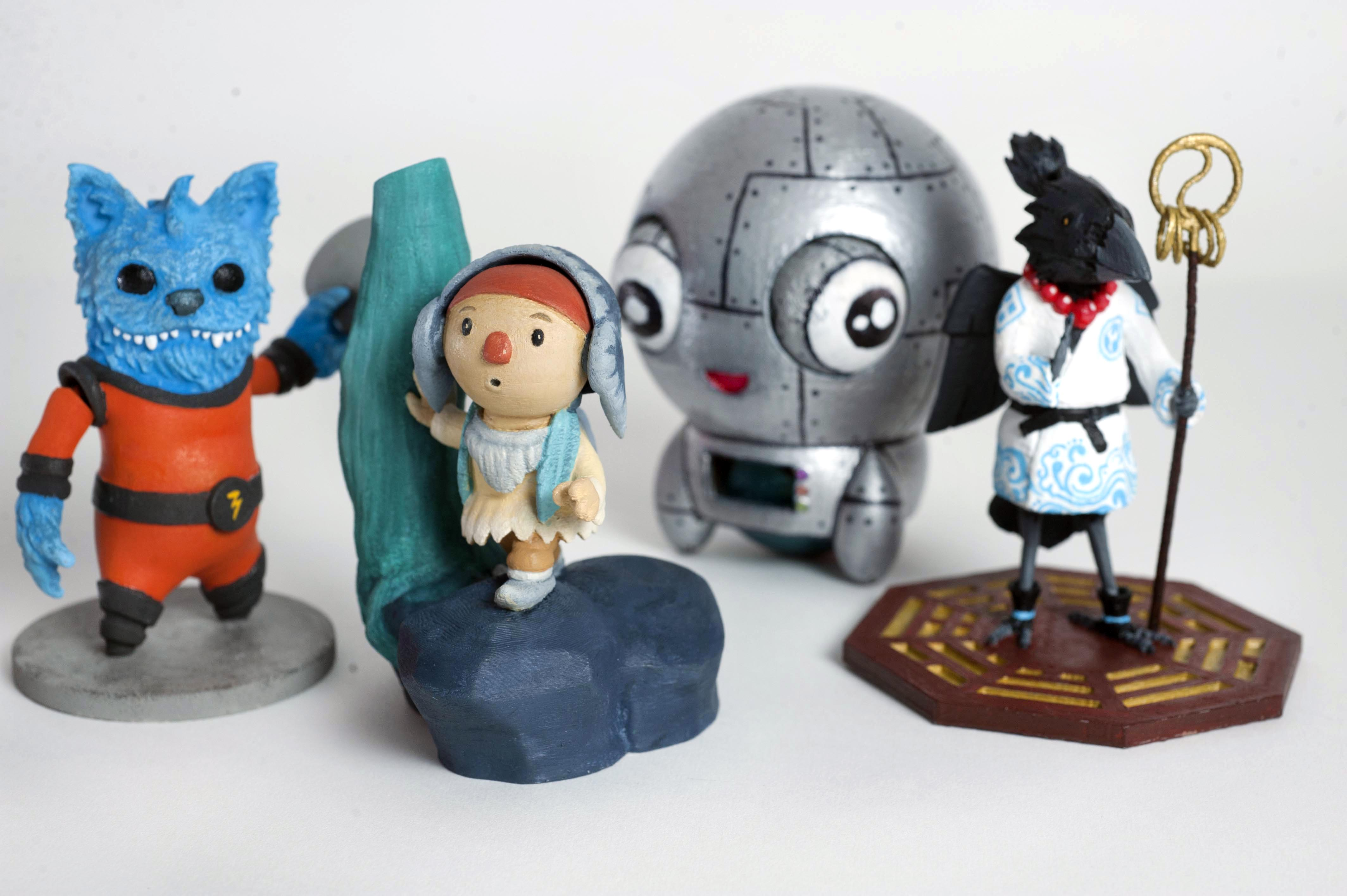 caption: Four stand out winners of the 3D Print Cup left to right: Best Individual - General Spike by Ashley Sparling, Best Character (overall winner) - Howl by Kilogramme, Best Student - Phropabot by Amy Mather and Best Team - Tengu-San by Draw & Code