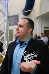 Nestegg Bio's 3D printed vasculature held by Gavon Carden.