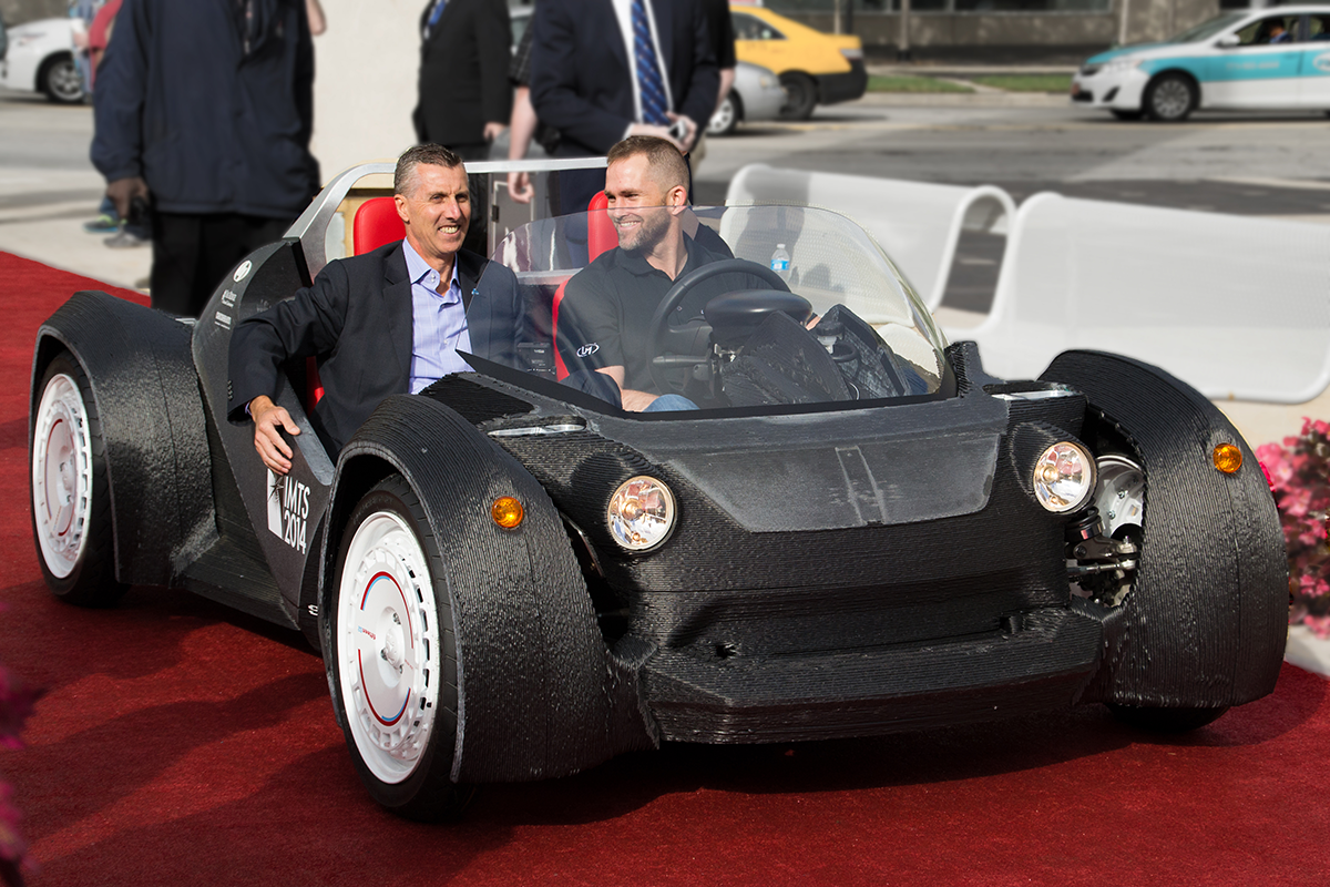 Local Motors CEO Jay Rodgers and AMT President in the Strati 3D Printed Car at IMTS