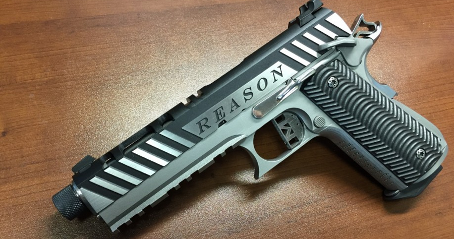 metal 3D printed gun from solid concepts employee