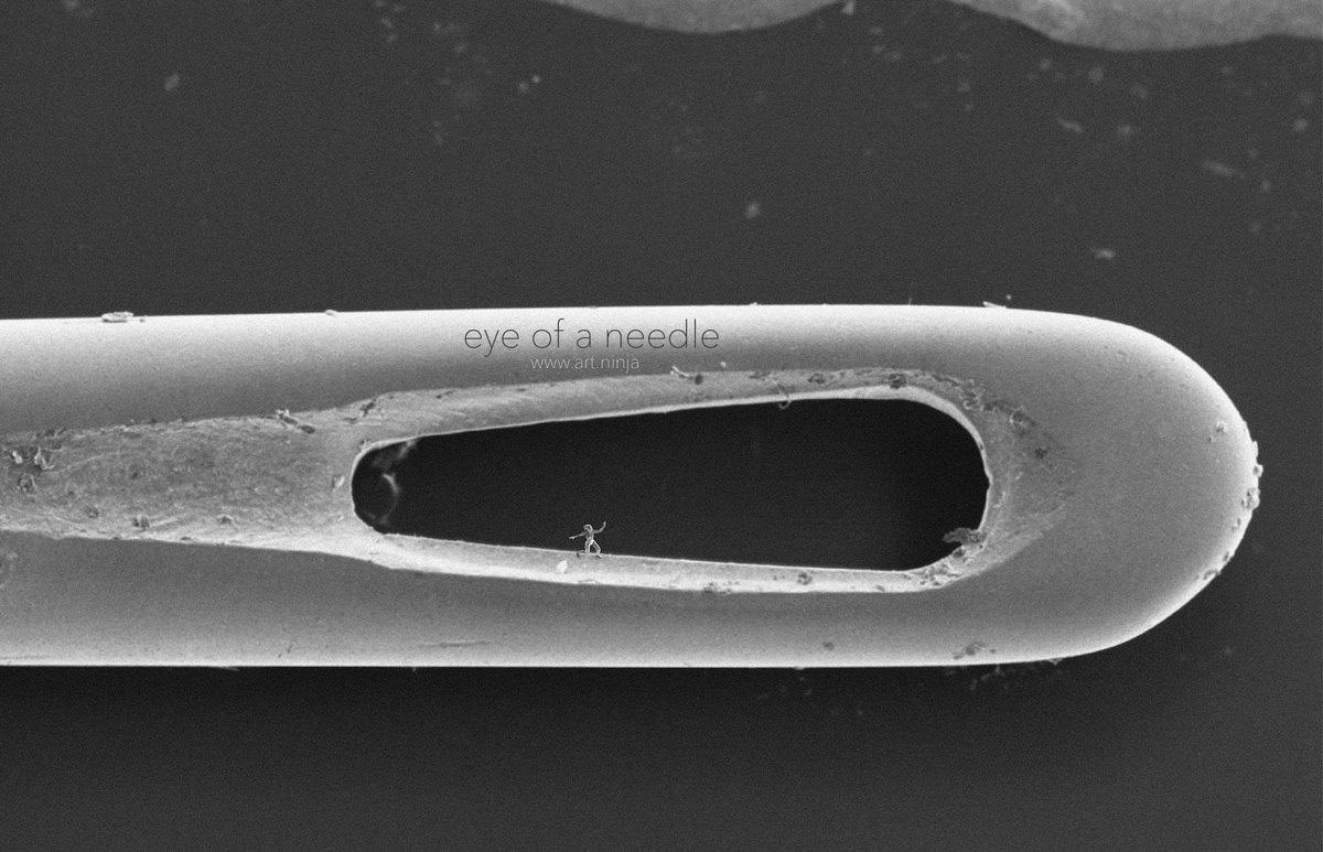 3D printed nanosculpture trust in needle by jonty hurwitz