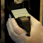 first 3D print from made in space 3D printer on ISS