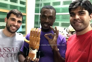 lead tech holds 3D printed prosthetic from e-nable in haiti