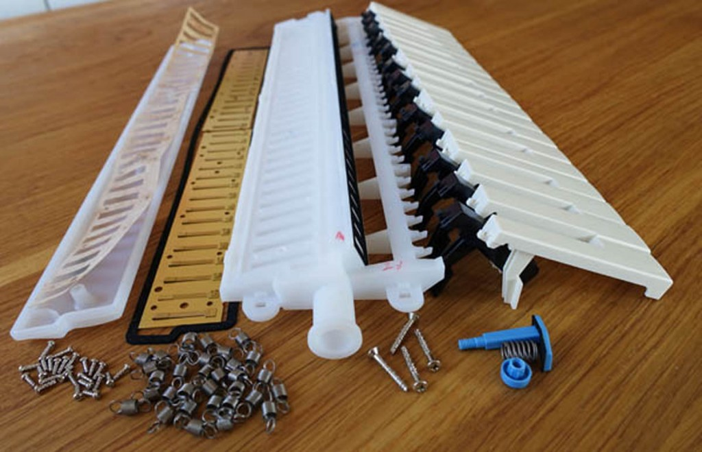 disassembled melodica for 3D printed melodica project by Daren Banarsë