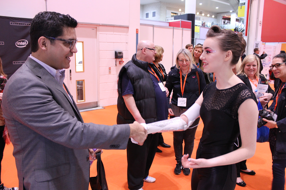 grace mandeville shaking hands with her open bionic 3d printed prosthetic