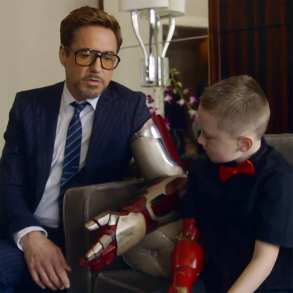robert downey jr. presents alex with 3D printed iron man bionic arm
