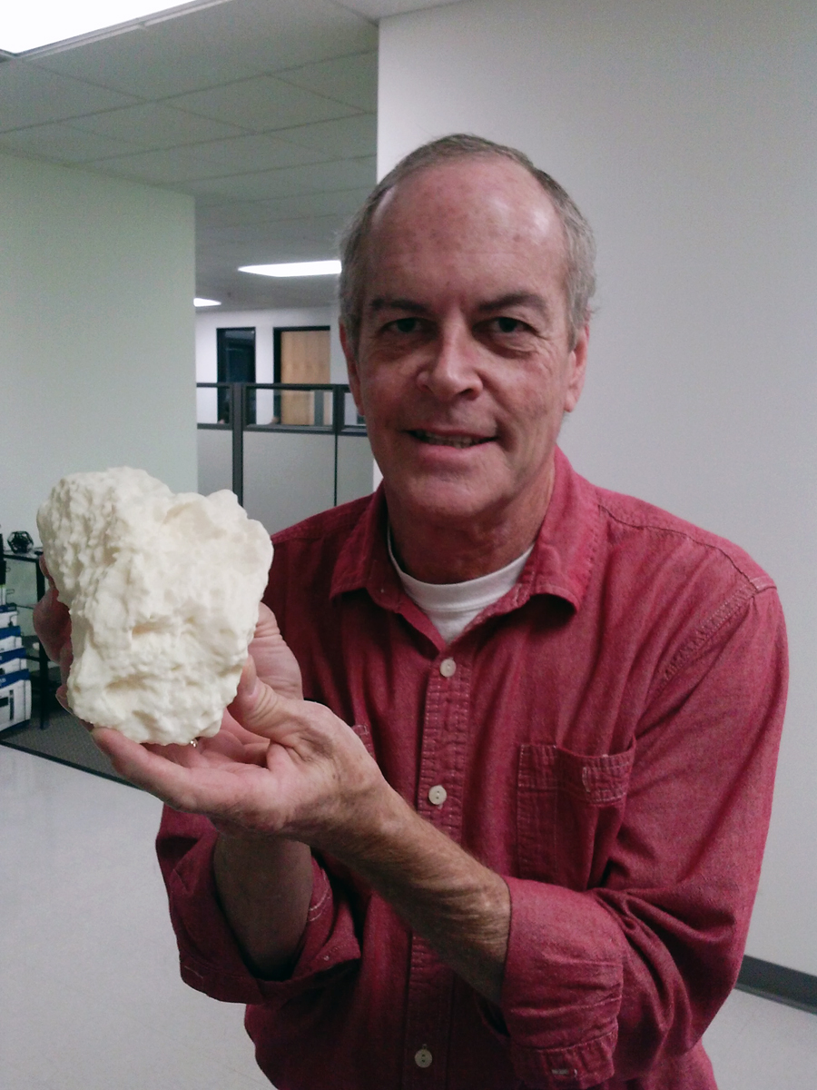 Glen Chancellor, 3D-Printer Specialist from GoEngineer, holds a 3D printed 1:25 scale of Block Island
