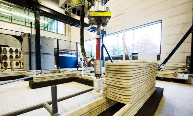 Traditional Construction concrete 3d printer breaks down walls of traditional construction