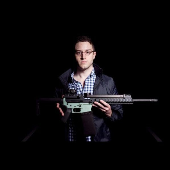 Cody Wilson holding and AR-15. Photo via Defense Distributed