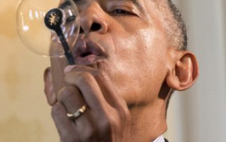 President Barack Obama blows a soap bubble using a 3-D printed bubble wand designed by Jacob Leggette, 9, of Baltimore, Md., while touring the 2016 White House Science Fair at the White House in Washington, Wednesday, April 13, 2016. (AP Photo/Jacquelyn Martin)