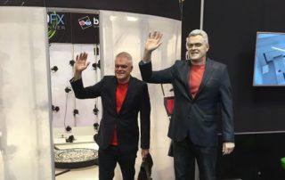 Presenter John Bentley with the bigger 3D printed John Bentley