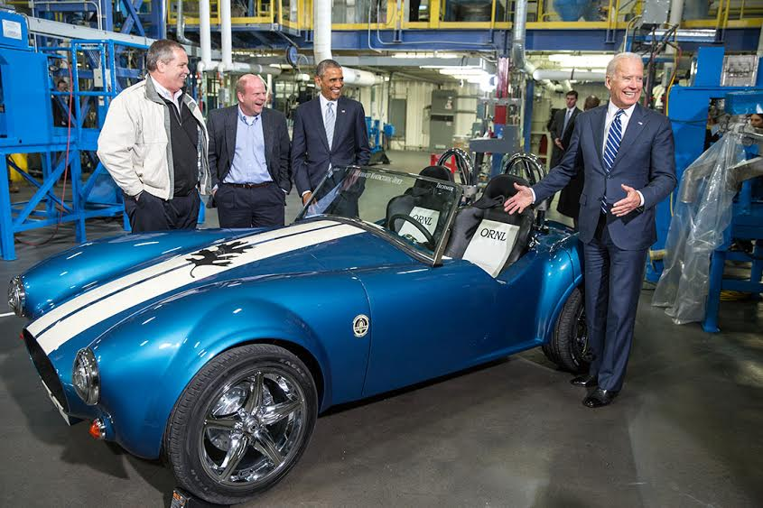 President Barack Obama and Vice President Joe Biden view a 3D printed carbon fiber Shelby Corbra car during a tour of Techmer PM in Clinton, Tenn., Jan. 9, 2015. They are joined by Lonnie Love, designer and manufacturer at Oak Ridge National Lab, and Tom Drye, Managing Director of Techmer ES. John Manuck, Chairman and CEO of Techmer PM. (Official White House Photo by Pete Souza)