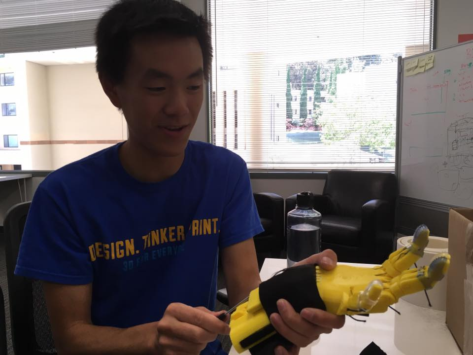 A UCLA student works on the bionic basketball hand