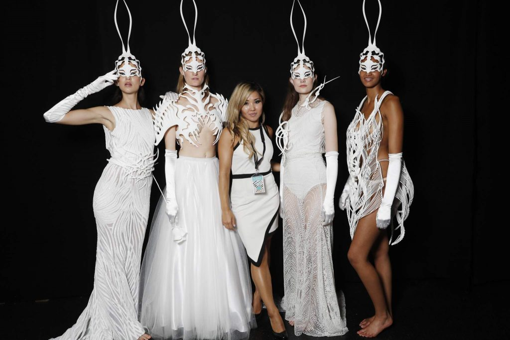 DUESSELDORF, GERMANY - JULY 23: Models pose with a createer of the show backstage ahead of the 3D Fashion Presented By Lexus show during Platform Fashion July 2016 at Areal Boehler on July 23, 2016 in Duesseldorf, Germany. (Photo by Andreas Rentz/Getty Images for Platform Fashion)