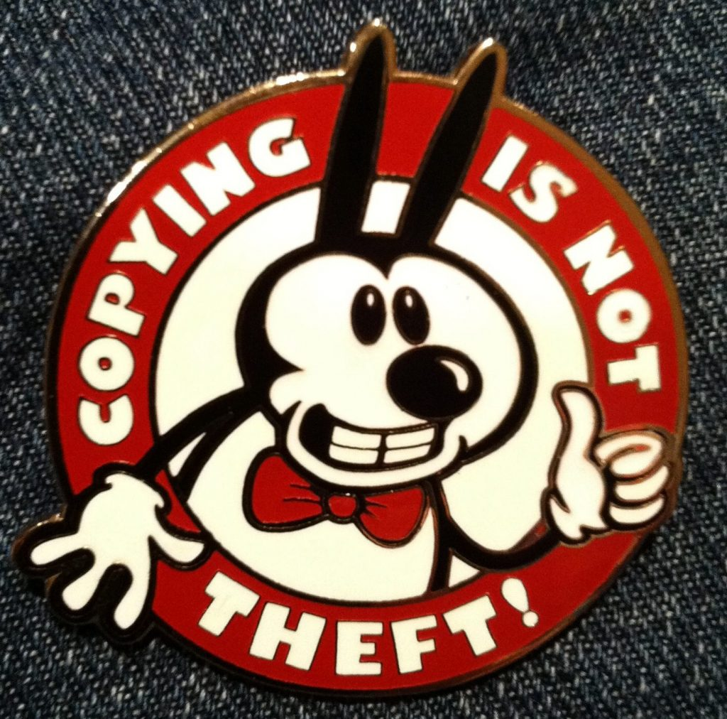"""Copying in not theft"" or is it? This is a badge with a character resembling Mickey Mouse in reference to the in popular culture rationale behind the Sonny Bono Copyright Term Extension Act of 1998, the badge was made by Nina Paley."