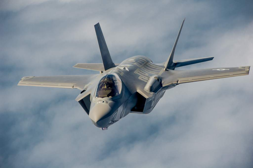 An F-35 Lightning II instructor pilots conduct aerial refueling.
