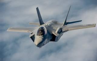 F-35 Lightning II instructor pilots conduct aerial refueling