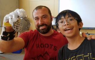 Calramon Mabalot and the teacher he helped with a 3D printed prosthetic hand. Photo via Calramon Mabalot on Twitter
