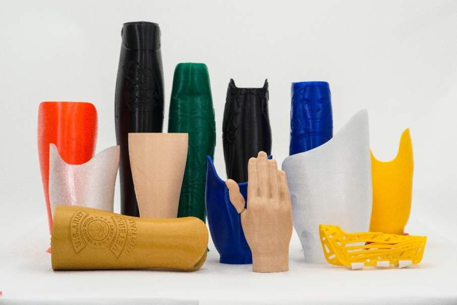 Create O&P 3D printed prostheses and leg covers. Photo via Create O&P