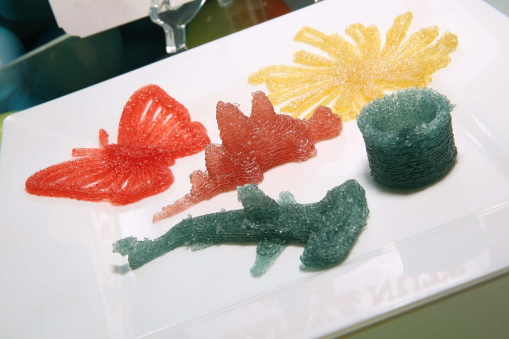 Gummy candy printed in the shape of a butterfly, a stegosaurus and a hammerhead shark. Photo via: Cindy Ord/Getty Images for Dylan's Candy Bar