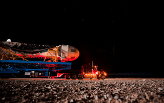 Blue Origin's reusable New Shepard space vehicle rolls out to the launch pad at the company's West Texas Launch Site.