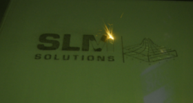 SLM Solutions Logo in Laser. Photo by Michael Petch.