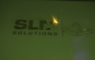 SLM Solutions Logo in Laser