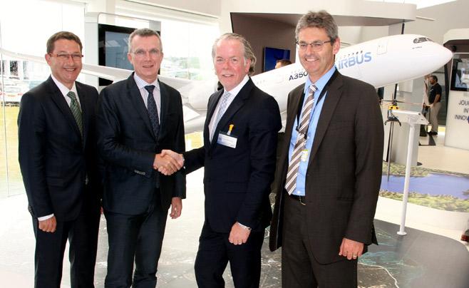 Airbus shake hands with Stratasys Photo via: Stratasys