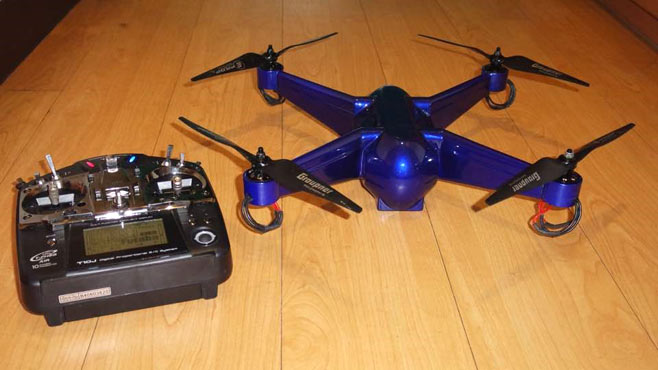 The 3D printed drone next to a transmitter for scale. Image via Stratasys blog.