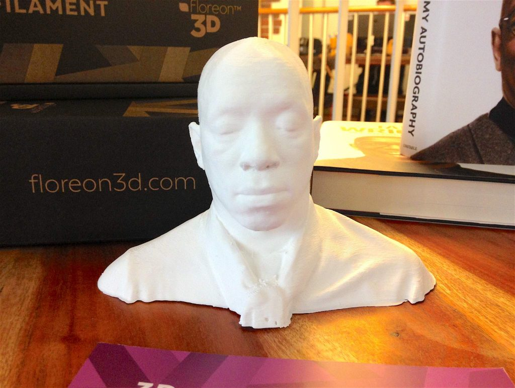 A miniature 3D printed bust of ex-footballer Ian Wright, used in a competition for MyMiniFactory designers to create a pair of glasses for the star. Photo by: Beau Jackson for 3DPI