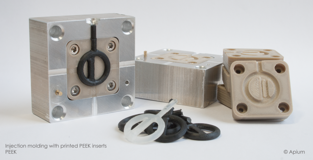 Injection molding with PEEK inserts Image via: Indmatec