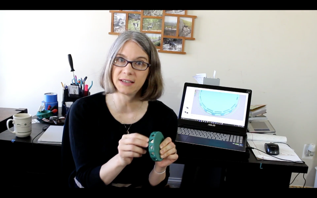 Vicky Somma explains how to embed mirrors in a 3D print. Screenshot via: TGAW on Youtube
