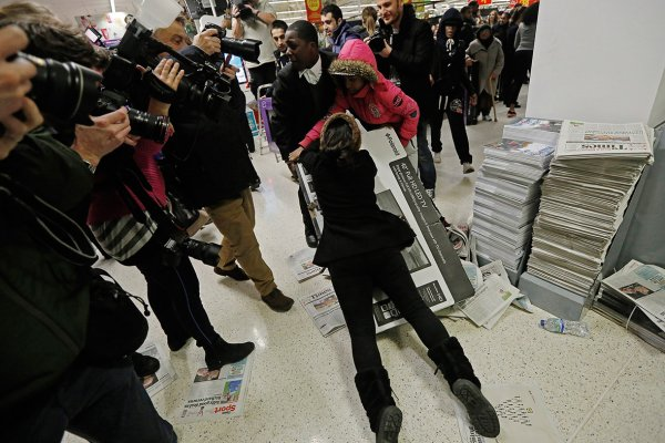 A Black Shopper getting carried away. Photo via Reuters.
