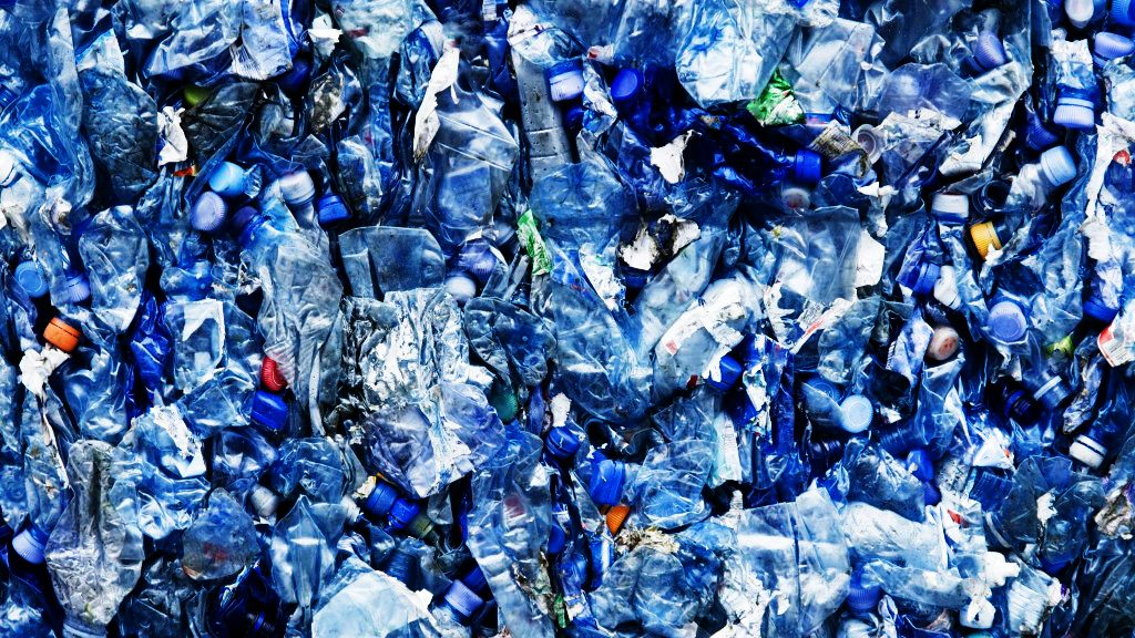 Plastic bottles are one of the things that can now be recycled using 3D printing. Photo of bottled in landfill via: ecowastecoalition on Blogspot