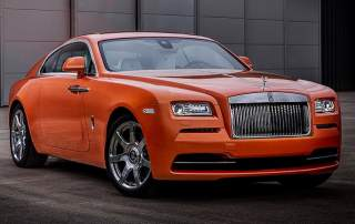 A bespoke orange metallic Rolls Royce Photo via: carscoops.com