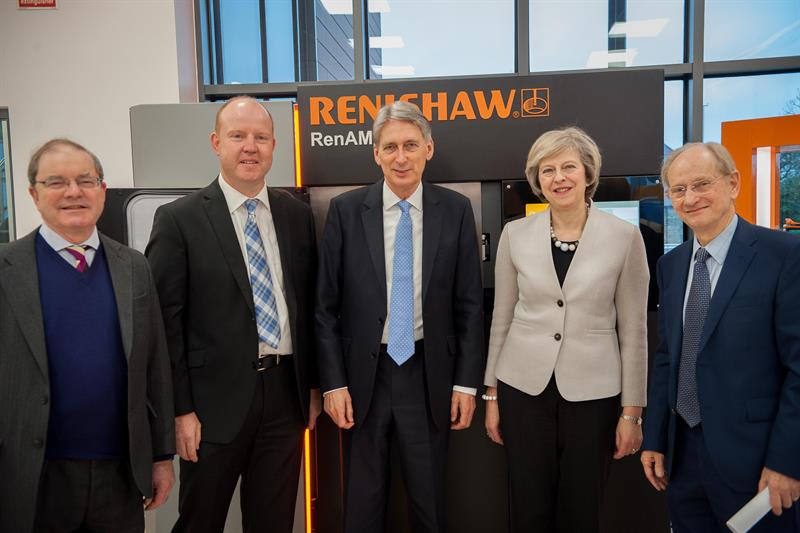 Sliced: Theresa May and the Chancellor of the Exchequer at Renishaw HQ in Gloucestershire. Photo via: machinery.co.uk