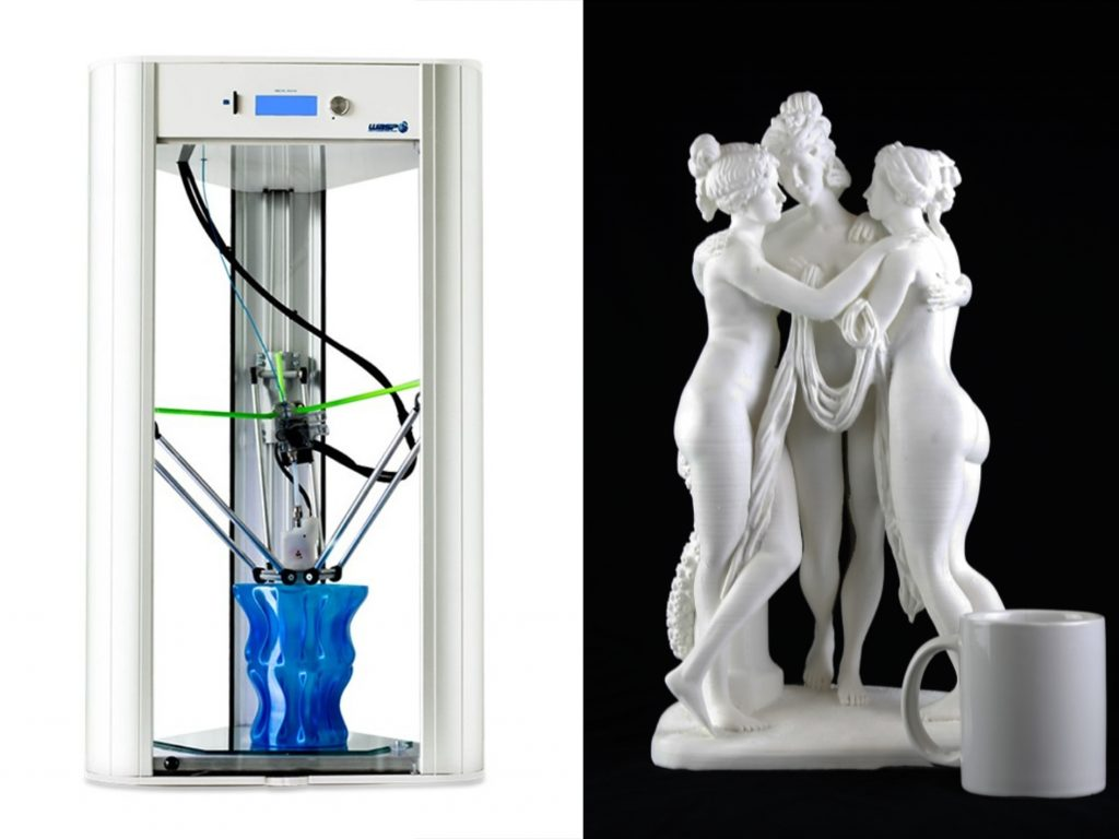 DeltaWASP 110v 20 X 40 3D Printer next to a statue printed to test its capabilities (mug for scale) Photos via: iMakr