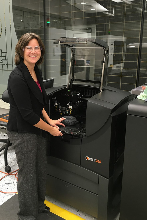 Am engineer with 3D printer at Caterpillar Inc's factory