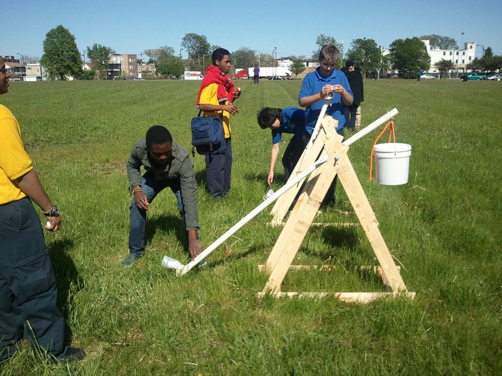 SYNCERE Project children build and test a catapult. Photo via: SYNCERE Project on Flickr