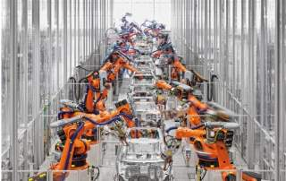 Kuka robotic arms art work in an automotive factory. Photo via: hepcoautomation