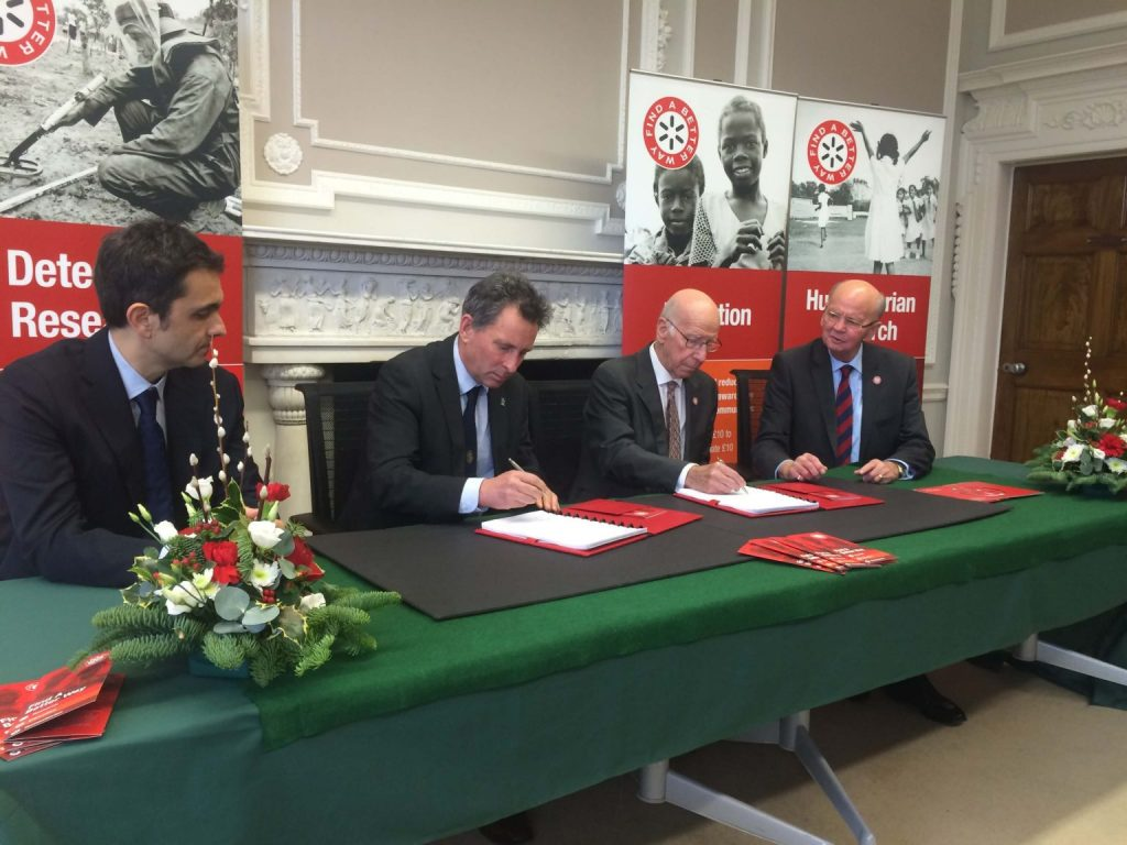 Sir Bobby Charlton signing the funding agreement. Photo via Find a Better Way.