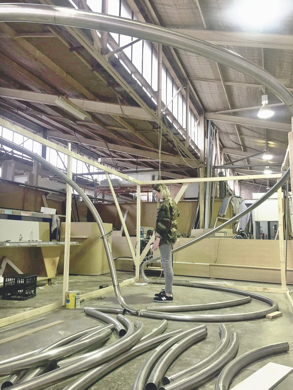 The steel frame in its parts being constructed. Image via Architecture and Design.