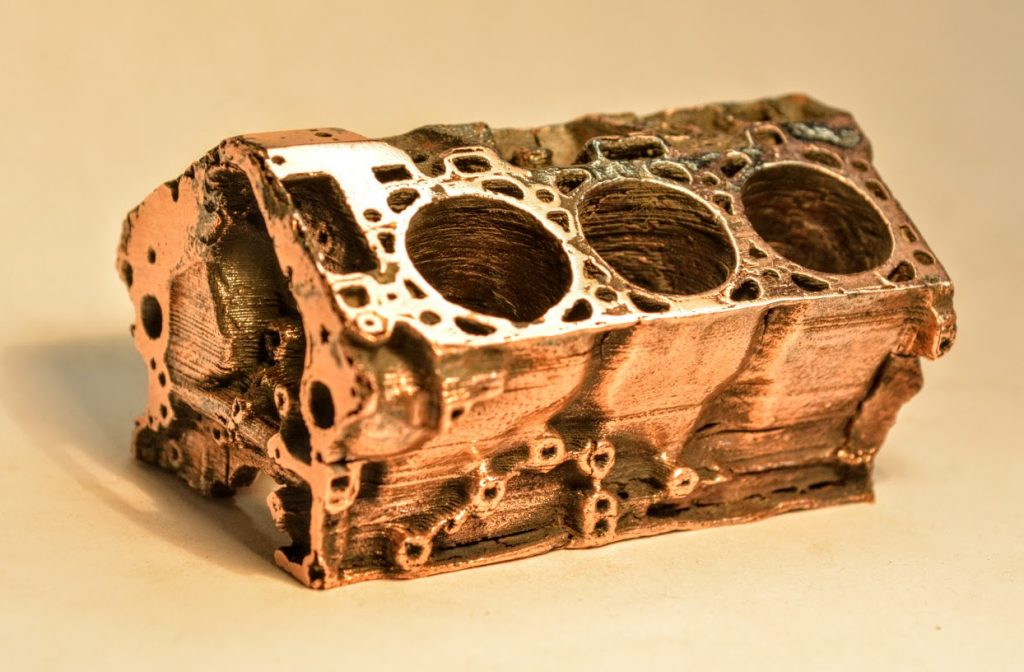 A Ford engine block printed in around $7 worth of Filamet Copper PLA. Photo via: The Virtual Foundry