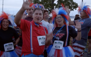 Enthusiastic runners at the IMTS Miles for Manufacturing (M4M) 5K race. Screenshot via: iSpy IMTS TV
