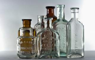 a selection of vintage apothecary medicine bottles. Photo via callmekato on Flickr.
