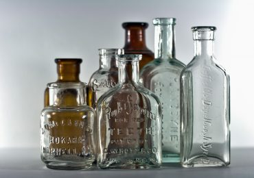 a selection of vintage apothecary medicine bottles. Photo via callmekato on Flickr.